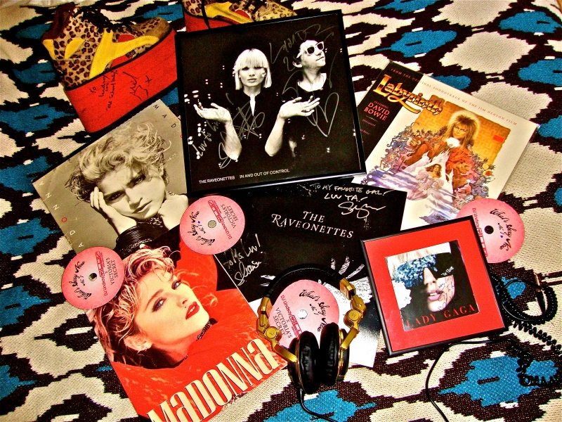 Assortment of Luv's favorite signed records, DJ headphones, Victoria's Secret Mixes, vintage Madonna tour booklet and more